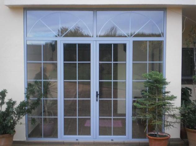 Aluminios garcilaso productos puertas de entrada de for Puertas de exterior con cristal