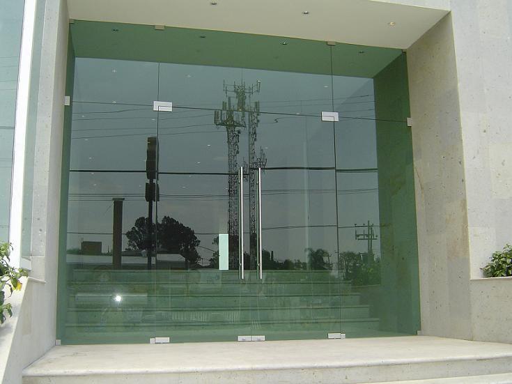 Aluminios garcilaso productos puertas de entrada de for Puertas de entrada con vidrio