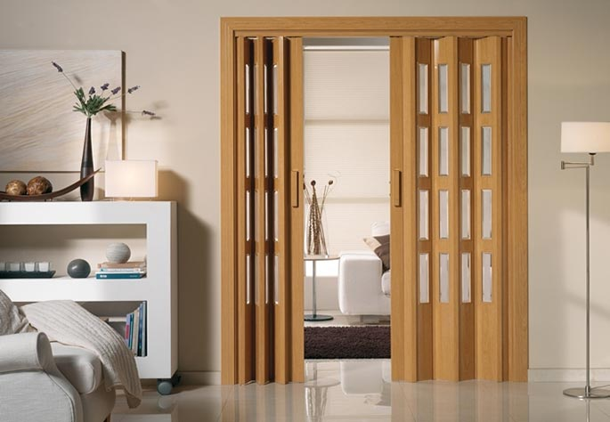 Aluminios garcilaso productos puerta plegable de pvc for Puertas plegables interior